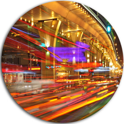 Designart Colorful Traffic Trails in City Cityscape Photo Circle Metal Wall Art