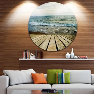 Designart Wooden Pier in Waving Sea Seascape Circle Metal Wall Art