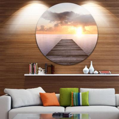 Designart Yellow Sea and Brown Pier Seascape Circle Metal Wall Art