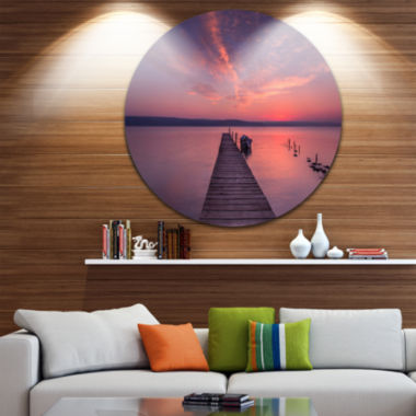 Designart Wooden Pier Under Red Sky Seascape Circle Metal Wall Art
