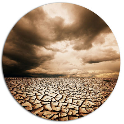 Design Art Cracked Drought Land with Dark Clouds Oversized Landscape Metal Circle Wall Art