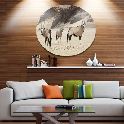 Designart Beautiful Wildebeests on Valley Landscape Metal Circle Wall Art