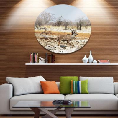 Designart Two Smart Wildebeests in Jungle Landscape Metal Circle Wall Art