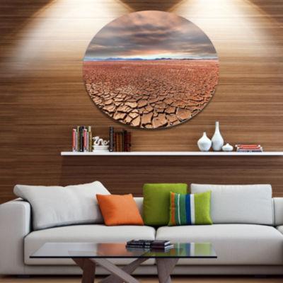 Designart Drought Land under Cloudy Sky African Landscape Metal Circle Wall Art