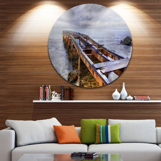 Design Art Old Rusty Pier in Cloudy Day Circle Metal Wall Art