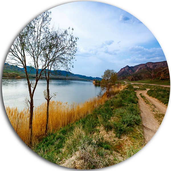 Design Art Blue River and Sky in Village Circle Metal Wall Art