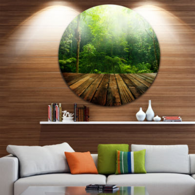 Design Art Green Forest with Ray of Light Landscape Photo Circle Metal Wall Art