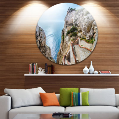 Design Art Stairway to Neptune s Grotto Ultra Vibrant Seascape Metal Circle Wall Art