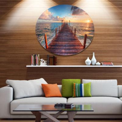 Design Art Sunset over Wooden Sea Pier Metal Circle Wall Art