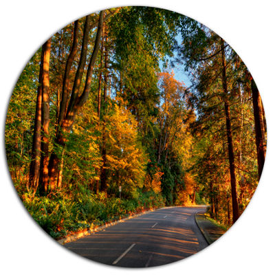 Design Art Road through Lit up Fall Forest Large Landscape Metal Circle Wall Art