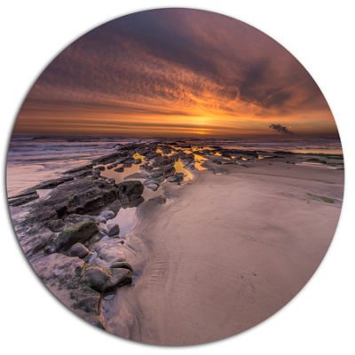Design Art Dramatic Sunrise over Sandy Beach Seashore Metal Circle Wall Art