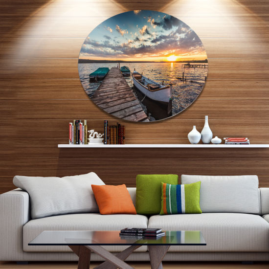 Design Art Boats and Jetty under Dramatic Sky Metal Circle Wall Art