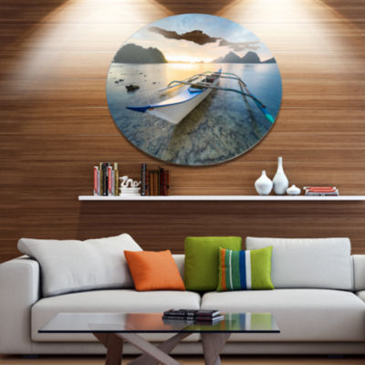 Design Art Boat Docked at Beautiful Sunset Seashore Metal Circle Wall Art