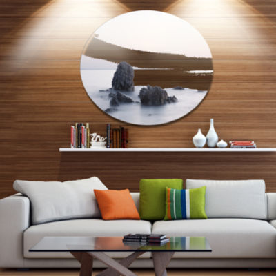 Design Art Rocks in the Sea Black and White Seashore Metal Circle Wall Art