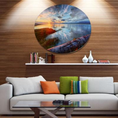 Design Art Colorful River Sunset With Log SeashoreMetal Circle Wall Art