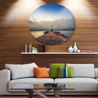 Design Art Lighthouse on Coast and Cloudy Sky Metal Circle Wall Art