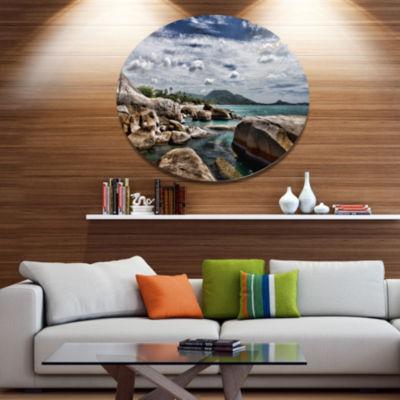 Design Art Rocky Beach with Dramatic Sky Large Seashore Metal Circle Wall Art