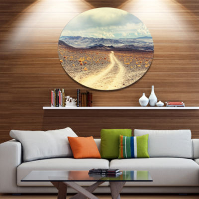 Design Art Dry Grass and Mountains in Argentina Oversized Landscape Metal Circle Wall Art