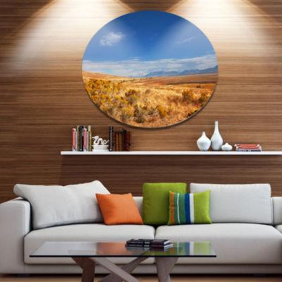 Design Art Expansive Prairie under Blue Sky Disc Landscape Circle Metal Wall Decor