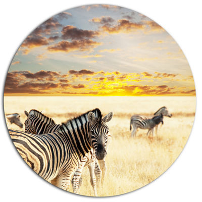 Design Art Zebras Walking in Bush under Clouds African Metal Circle Wall Art