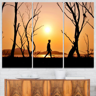 Designart Man Walking Alone In Evening LandscapePhotography Canvas Print - 3 Panels