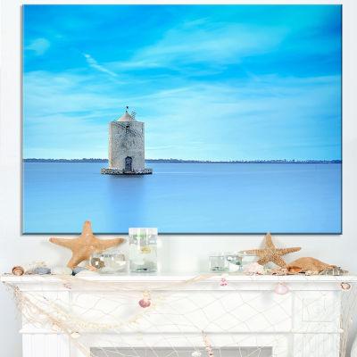 Designart Old Spanish Windmill In Blue Lagoon Canvas Art