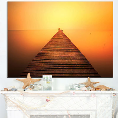 Designart Old Wooden Bridge Into Infinity Sea Canvas Art