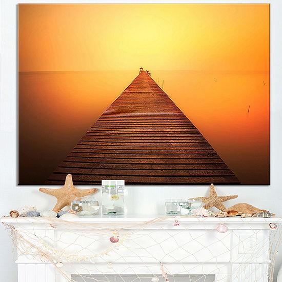 Designart Old Wooden Bridge Into Infinity Sea Canvas Art