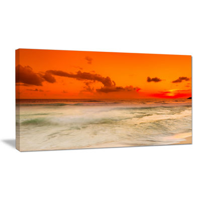 Designart Orange Sky And Wide Sandy Beach Canvas Art