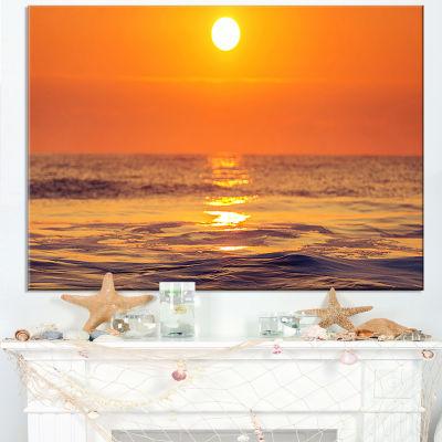 Designart Orange Sunrise And Glittering Waters Canvas Art