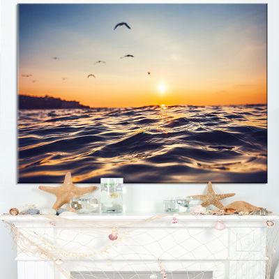 Designart Orange Tinged Sea Waters At Sunrise Canvas Art