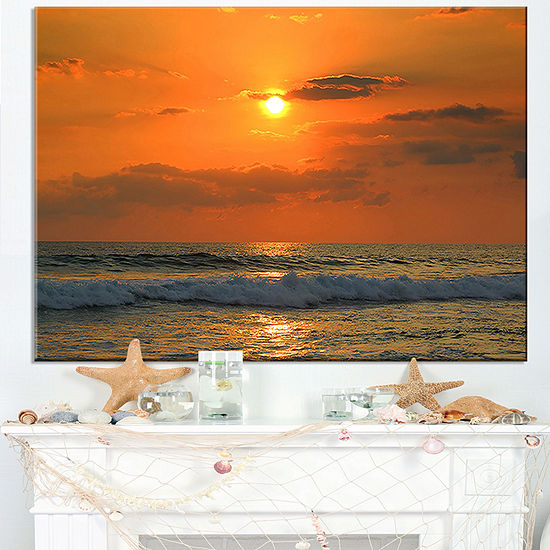 Designart Orange Tinged Tropical Sunset And Waves Canvas Art