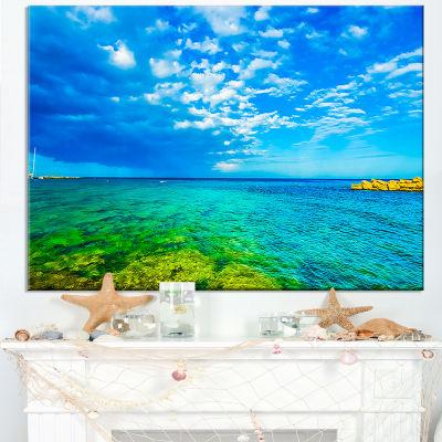 Designart Picturesque Green Blue Seashore Canvas Art