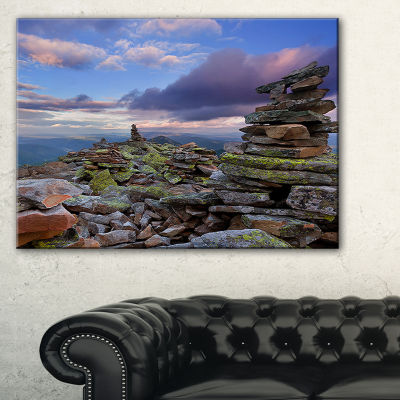 Designart Piled Stones In Summer Mountains Canvas Art