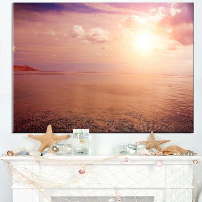 Designart Pink Sky Over Dark Beach At Sunset Canvas Art