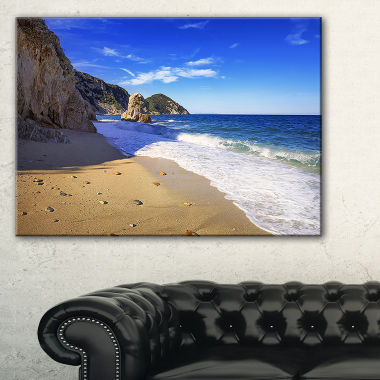 Designart Portoferraio Sansone Sorgente Beach Canvas Art