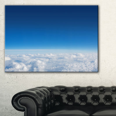 Designart Puffy Clouds Above View Canvas Art