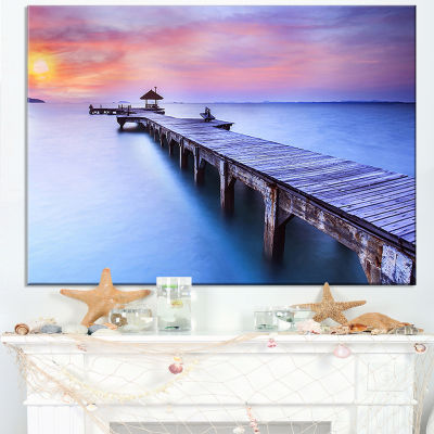 Designart Purple Seas And Long Wooden Pier Canvas Art