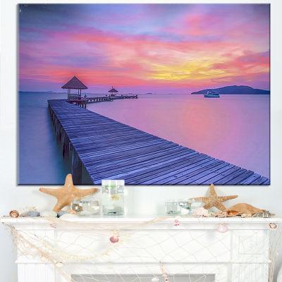 Designart Purple Tinged Wood Bridge And Beach Canvas Art