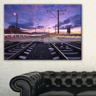 Designart Rail Crossing With Blurred Car Lights Canvas Art