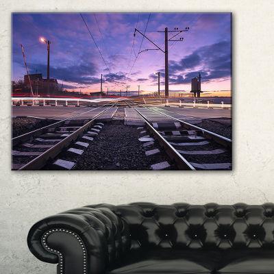 Designart Rail Crossing With Blurred Car Lights Canvas Art