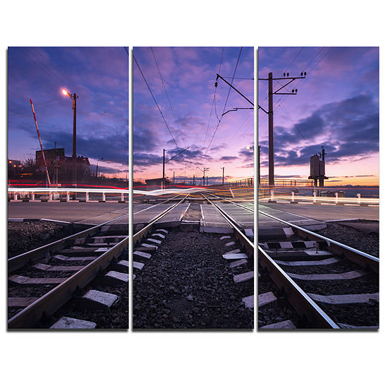 Designart Rail Crossing With Blurred Car Lights 3-pc. Canvas Art