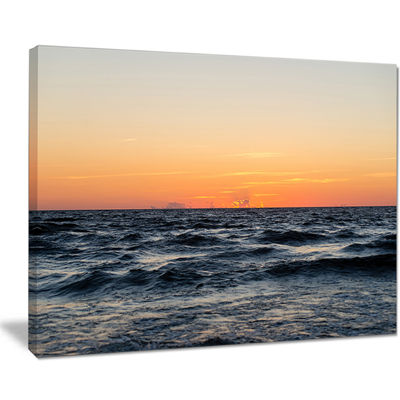 Designart Red Dramatic Sunset Over Beach Canvas Art