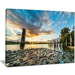 Designart Riverside Sunset With Wood Canvas Art