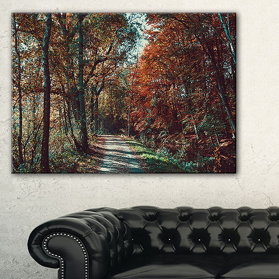 Designart Road Through Red Fall Forest Canvas Art