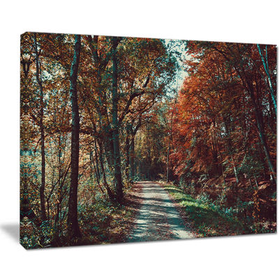 Designart Road Through Red Fall Forest Canvas Art