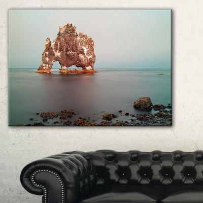 Designart Rock Sea Symbol In Iceland Canvas Art