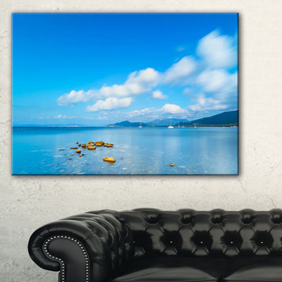 Designart Rocks In A Blue Panoramic Sea Bay Canvas Art