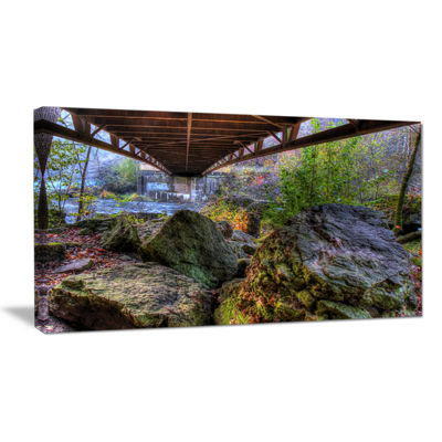 Designart Large Rocks Under Bridge In Creek Canvas Art