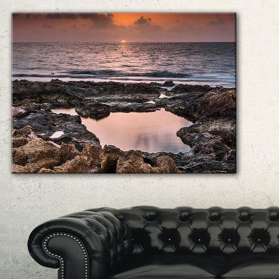 Designart Rocky African Coastline Sunset Canvas Art